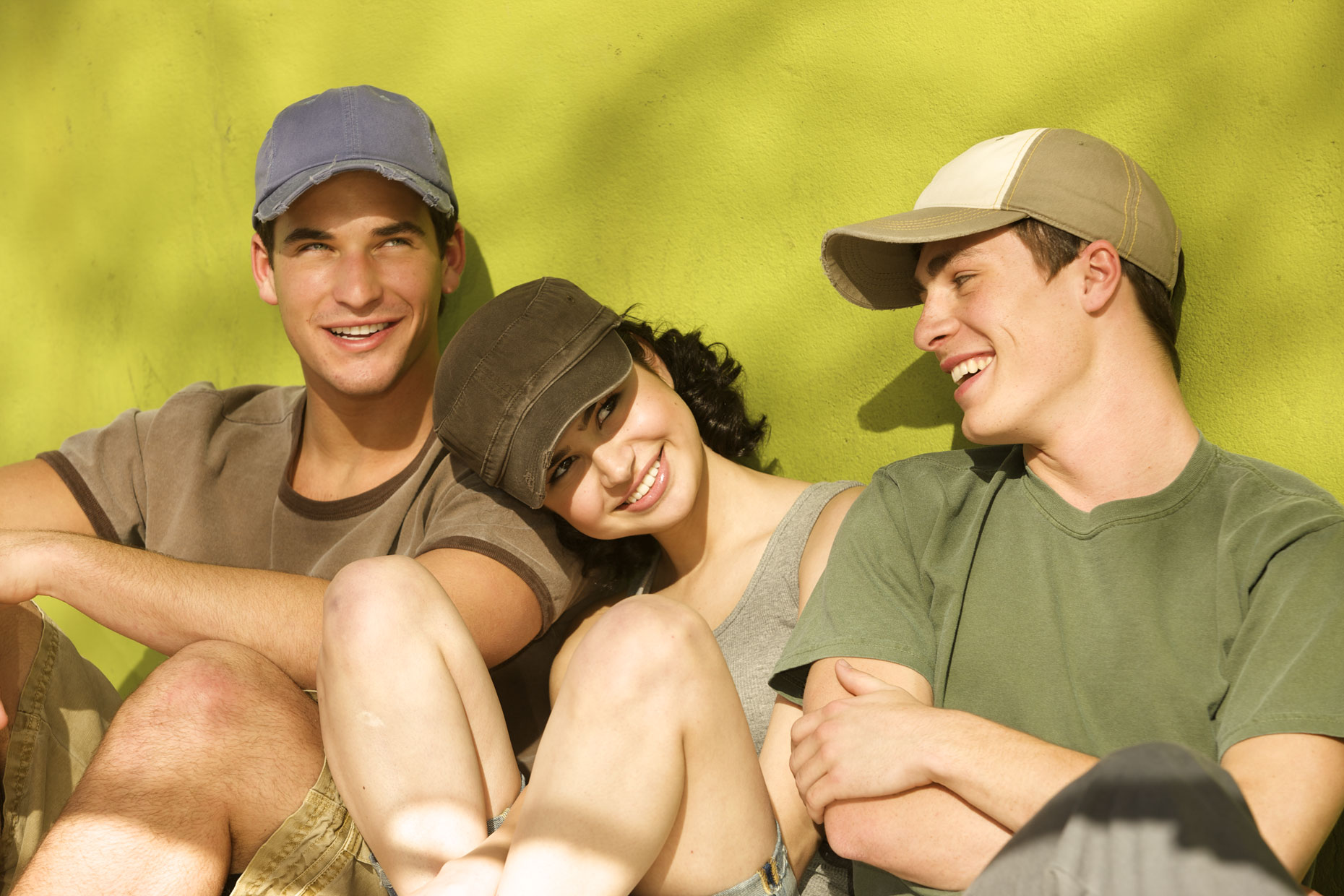 Young teens relaxing in hats.