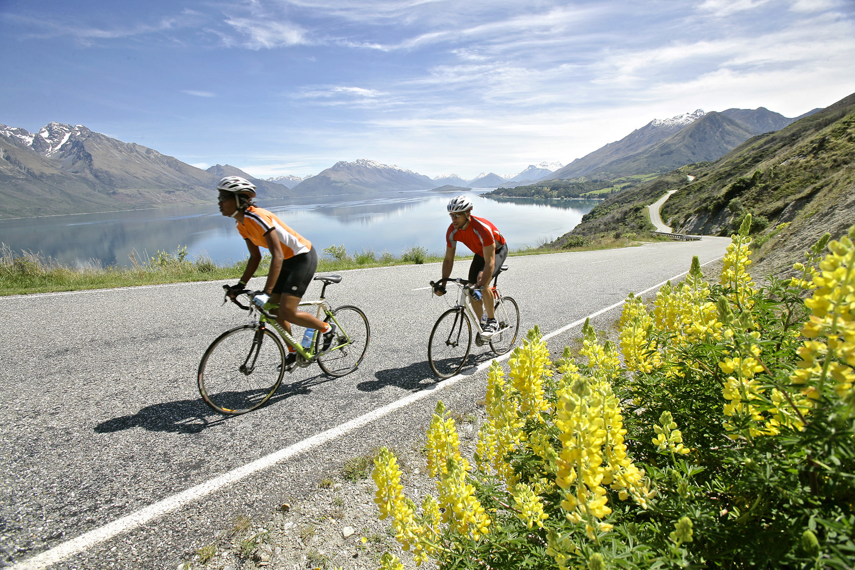Road Bikers traverse the shoreline in New Zealand/Steve Mason Photograhy