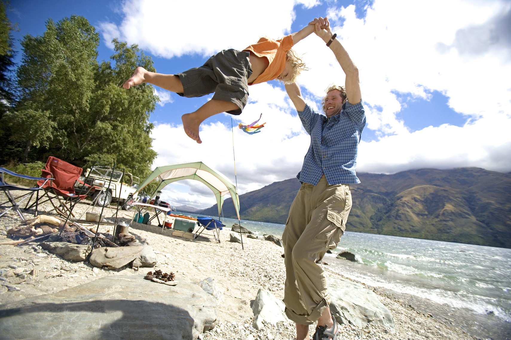 Father and son enjoy camping in New Zealand/Steve Mason Photography